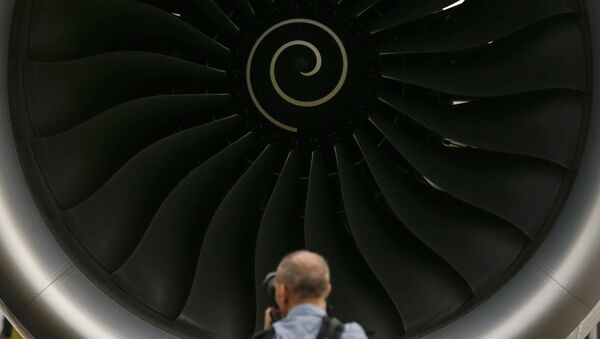 A visitor takes a photo of the Rolls-Royce jet engine of the Airbus A350-1000 parked at the static display area during the Singapore Airshow on Wednesday, Feb. 7, 2018, in Singapore. - Sputnik International