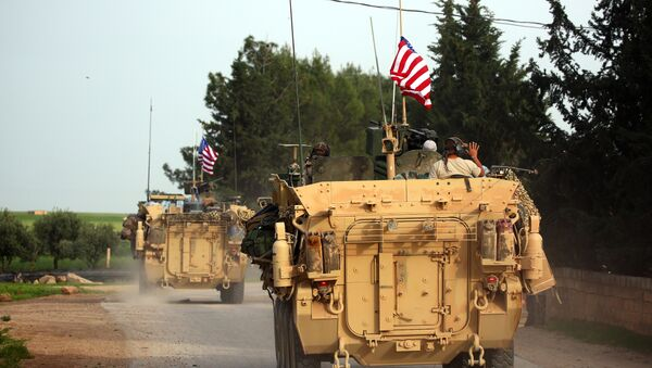 US forces, accompanied by Kurdish People's Protection Units (YPG) fighters, drive their armoured vehicles near the northern Syrian village of Darbasiyah, on the border with Turkey on April 28, 2017. (File) - Sputnik International