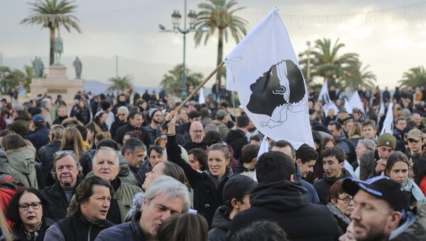 Residents of the Corsica island take the streets in Ajaccio, France, as they demonstrate ahead of a visit to the Mediterranean island next week by French President Emmanuel Macron, Saturday, Feb. 3, 2018 - Sputnik International
