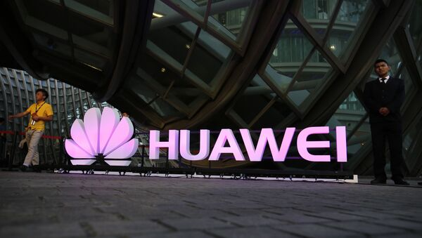Logo for Huawei at a launch event for the Huawei MateBook in Beijing - Sputnik International