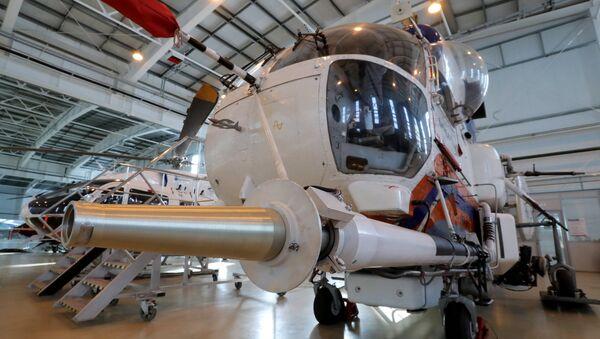 A MAC Ka-32A with precision fire extinguishing system attached. - Sputnik International