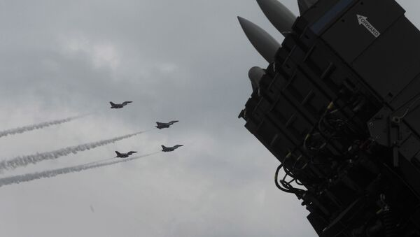 F-16 fighter jets and surface-to-air missile system (File) - Sputnik International