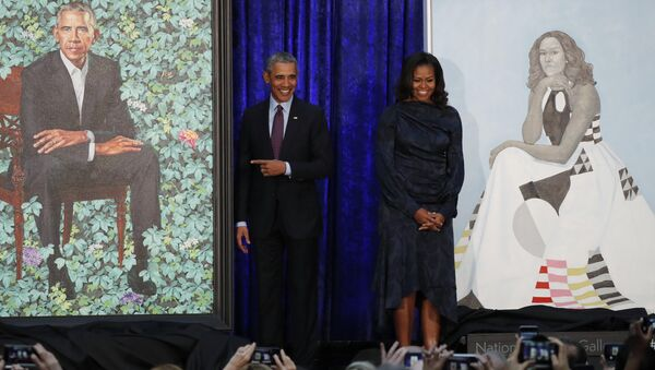 Former U.S. President Barack Obama and former first lady Michelle Obama stand with their portraits during an unveiling ceremony at the Smithsonian's National Portrait Gallery in Washington, U.S., February 12, 2018. - Sputnik International