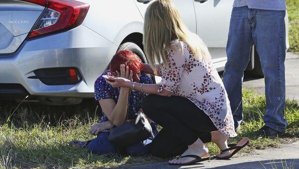 A woman consoles another as parents wait for news regarding a shooting at Marjory Stoneman Douglas High School in Parkland, Fla., Wednesday, Feb. 14, 2018. - Sputnik International