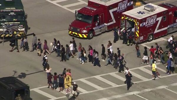 Students are evacuated from Marjory Stoneman Douglas High School during a shooting incident in Parkland, Florida, U.S. February 14, 2018 in a still image from video - Sputnik International