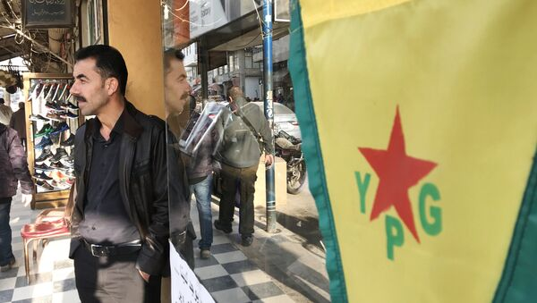 Flag of the Kurdish YPG self-defense forces on the central street of the city of Afrin, Syria - Sputnik International