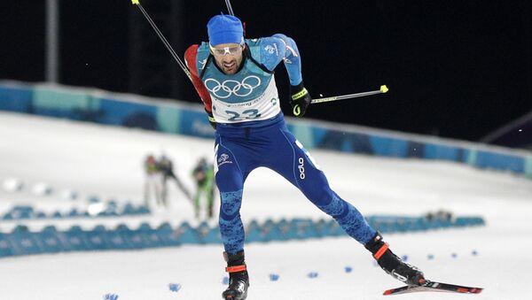 Martin Fourcade, of France, skis across the finish line during the men's 20-kilometer individual biathlon at the 2018 Winter Olympics in Pyeongchang, South Korea - Sputnik International