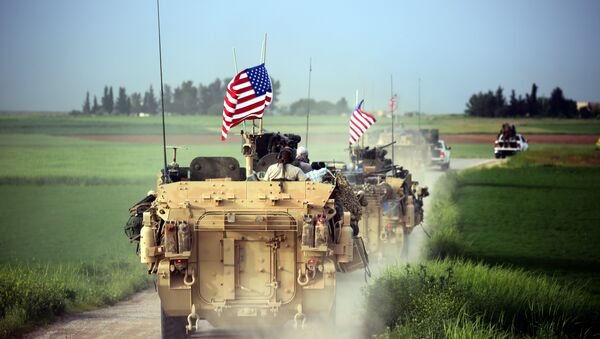 US forces, accompanied by Kurdish People's Protection Units (YPG) fighters, drive their armoured vehicles near the northern Syrian village of Darbasiyah, on the border with Turkey on April 28, 2017 - Sputnik International