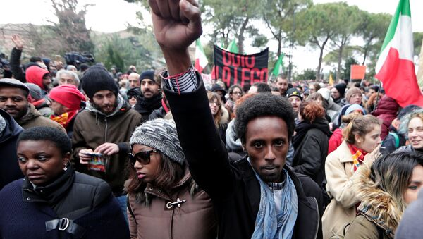 Demonstrators march during an anti-racism rally in Macerata, Italy, February 10, 2018 - Sputnik International