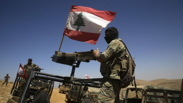 Lebanese soldiers sit on top of an armored personnel carrier (File) - Sputnik International