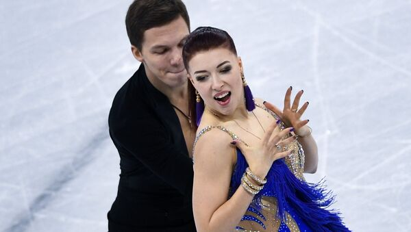 Yekaterina Bobrova and Dmitry Solovyov (Russia) perform their short program in the ice dance competition at the XXIII Olympic Winter Games - Sputnik International