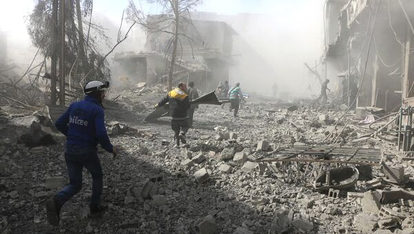 Members of the Syrian Civil Defense run to help survivors from a street that attacked by airstrikes and shelling of the Syrian government forces, in Ghouta, suburb of Damascus, Syria - Sputnik International