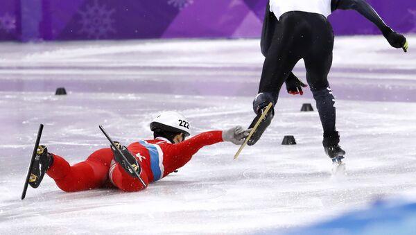 Short Track Speed Skating Events - Pyeongchang 2018 Winter Olympics - Men's 500 m Competition - Gangneung Ice Arena - Gangneung, South Korea - February 20, 2018. Keita Watanabe of Japan in action as Jong Kwang Bom of North Korea falls - Sputnik International