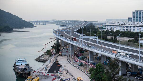 In this picture taken on November 29, 2017, a general view shows a section of the Hong Kong-Zhuhai-Macau Bridge (HKZMB) (C) that runs alongside the international airport (R) in Hong Kong - Sputnik International