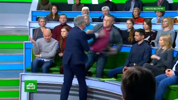 A video has been released showing a fight take place during the latest release of the online political talk show Mesto Vstrechi (the Meeting Place) on the Russian channel NTV - Sputnik International