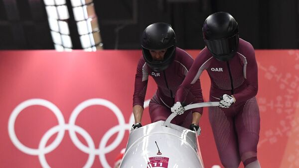 Russia's Nadezhda Sergeeva (R) and Russia's Anastasia Kocherzhova compete in the women's bobsleigh heat 1 run during the Pyeongchang 2018 Winter Olympic Games, at the Olympic Sliding Centre on February 20, 2018 in Pyeongchang - Sputnik International