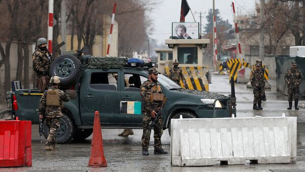 Afghan security forces keep watch at a check point near the site of a suicide attack in Kabul, Afghanistan February 24, 2018 - Sputnik International