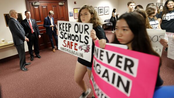 Student survivors from Marjory Stoneman Douglas High School, where 17 students and faculty were killed in a mass shooting on Wednesday, walk past the house legislative committee room, to talk to legislators at the state Capitol, regarding gun control legislation, in Tallahassee, Fla., Wednesday, Feb. 21, 2018 - Sputnik International