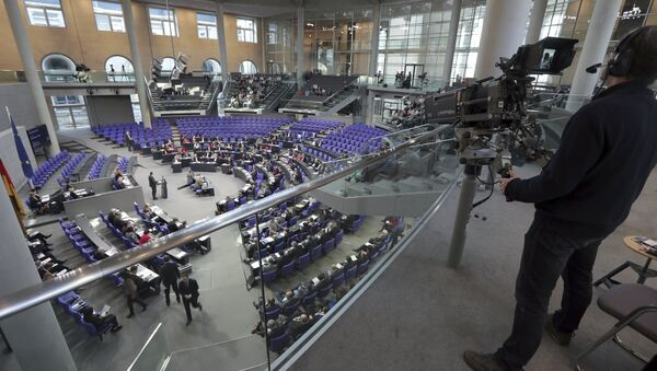 In this Friday, Feb. 2, 2018 photo a cameraman films a meeting of the German Federal Parliament, Bundestag, at the Reichstag building in Berlin, Germany. - Sputnik International