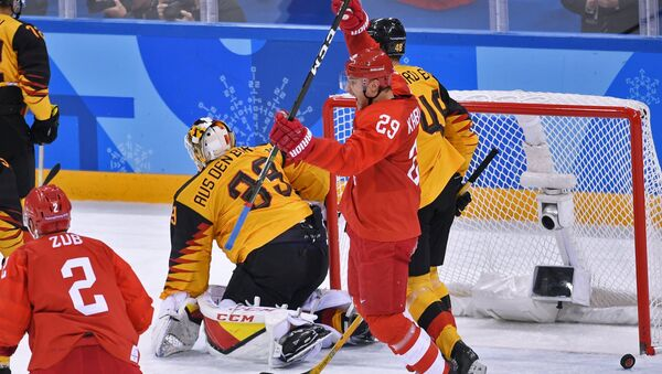 From left: Frank Hordler (Germany), Ilya Kablukov (Russia) and Danny aus den Birken (Germany) during the final match between Russia and Germany in the men's ice hockey tournament at the 2018 Winter Olympics. - Sputnik International