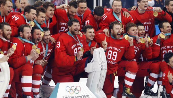 Ice Hockey - Pyeongchang 2018 Winter Olympics - Men's Final Match - Russia - Germany - Gangneung Hockey Centre, Gangneung, South Korea - February 25, 2018 - Russian team reacts with their gold medals - Sputnik International