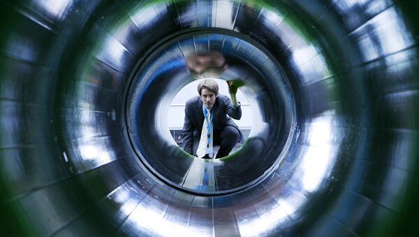 A man looks into a tube representing a natural gas pipeline at the booth of Nord Stream at the Hanover industrial fair in Hanover, Germany (File) - Sputnik International