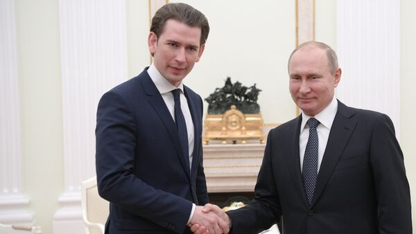 Russian President Vladimir Putin and Chancellor of Austria Sebastian Kurz, left, during a meeting - Sputnik International