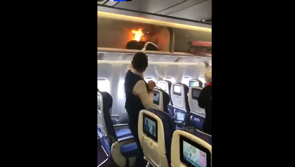 Carry-on bag inside overhead compartment on China Southern Airlines flight goes up in flames - Sputnik International