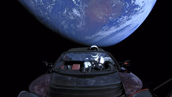 SpaceX CEO Elon Musk's own car, red Tesla Roadster cabrio, entered into orbit by the Falcon Heavy launcher, with a dummy wearing a spacesuit at the steering wheel, in outer space - Sputnik International