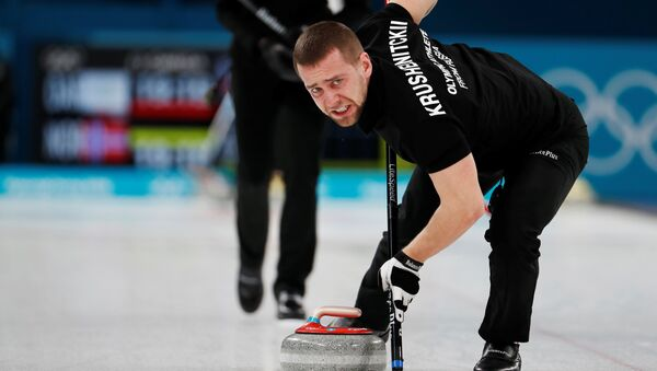 Curling Pyeongchang 2018 Winter Olympics Mixed Doubles Bronze Medal Match - Olympic Athletes from Russia v Norway - Gangneung Curling Center - Gangneung, South Korea February 13, 2018 - Alexander Krushelnitsky, an Olympic athlete from Russia, sweeps - Sputnik International