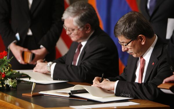 (File) Armenia's Foreign Minister Edouard Nalbandian, left, and Turkey's Foreign Minister Ahmet Davutoglu sign documents during the signing ceremony of a peace accord between Turkey and Armenia in Zurich, Switzerland Saturday Oct. 10, 2009 - Sputnik International