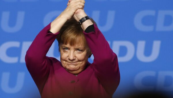 German Chancellor and party chairwoman Angela Merkel acknowledges the applause of the delegates after her speech during the party convention of the Christian Democratic Union CDU in Berlin, Germany, Monday, Feb. 26, 2018 - Sputnik International