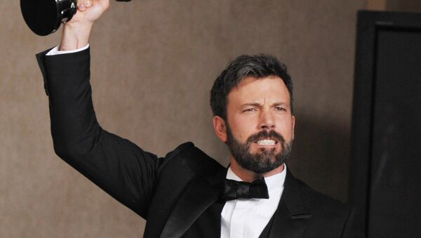 Ben Affleck poses with his award for best picture for Argo during at the Oscars at the Dolby Theatre on Sunday Feb. 24, 2013, in Los Angeles.  - Sputnik International