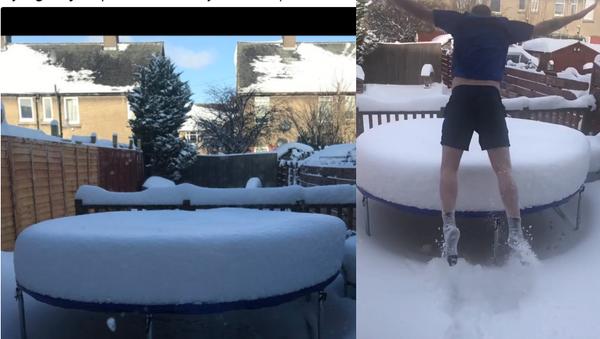 Brrrave: Bold Man Belly-Flops on Snowy Trampoline - Sputnik International