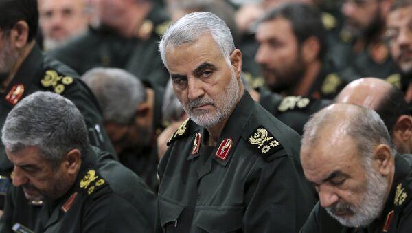 Revolutionary Guard Gen. Qassem Soleimani, center, attends a meeting with Supreme Leader Ayatollah Ali Khamenei and Revolutionary Guard commanders in Tehran, Iran, file photo. - Sputnik International