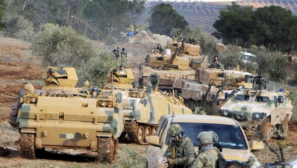 Turkish troops take control of Bursayah hill, which separates the Kurdish-held enclave of Afrin from the Turkey-controlled town of Azaz, Syria, Sunday, Jan. 28, 2018 - Sputnik International
