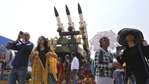 Spectators stand next to the models of Akash, surface-to-air missile, as they watch fighter aircraft perform on the fourth day of Aero India 2017 at Yelahanka air base in Bangalore, India, Friday, Feb. 17, 2017 - Sputnik International