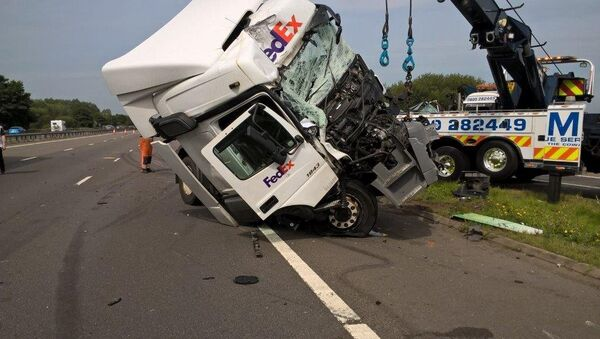 Wagstaff's Fed Ex truck (pictured) ploughed into the back of a minibus carrying 11 passengers to Disneyland Paris - Sputnik International