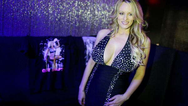 Adult-film actress Stephanie Clifford, also known as Stormy Daniels, poses for pictures at the end of her striptease show in Gossip Gentleman club in Long Island, New York, U.S., February 23, 2018. - Sputnik International