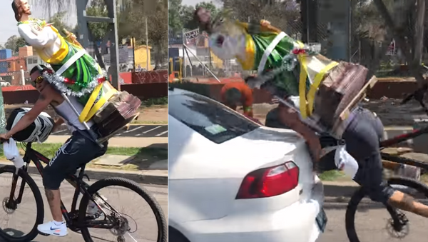 Distracted Cyclist Faceplants, Shatters St. Jude Statue in Collision - Sputnik International