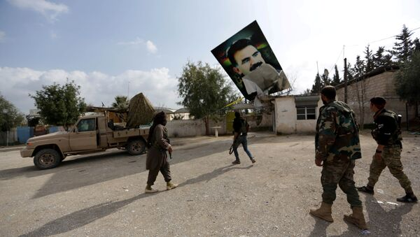 Turkish-backed Free Syrian Army fighters remove a picture of Kurdistan Workers Party (PKK) leader Abdullah Ocalan in Kafr Jana village north of Afrin, Syria March 7, 2018 - Sputnik International