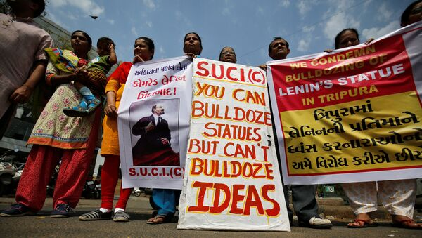 Activists of Socialist Unity Centre of India (SUCI) hold placards and shout anti-government slogans during a protest against what they say was the demolition of a statue of Vladimir Lenin in the northeastern state of Tripura on Monday, in Ahmedabad, India, March 7, 2018 - Sputnik International