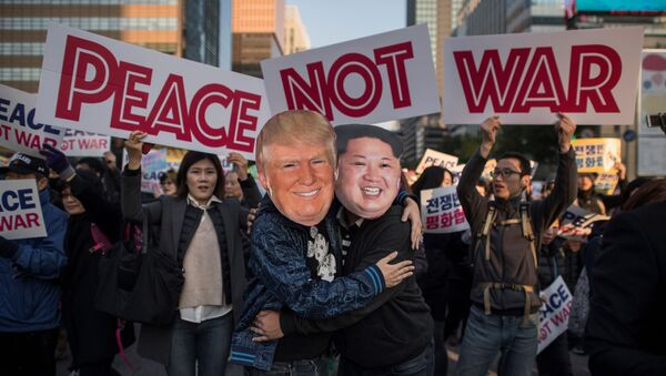 Demonstrators dressed as North Korean leader Kim Jong-Un (R) and US President Donald Trump (L) embrace during a peace rally in Seoul on November 5, 2017 - Sputnik International