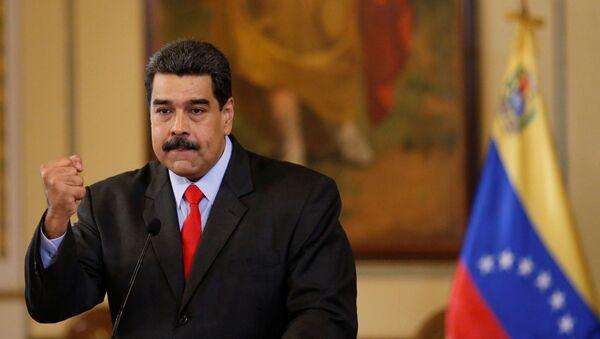 Venezuela's President Nicolas Maduro gestures as he talks to the media during a news conference in Caracas, Venezuela February 15, 2018 - Sputnik International