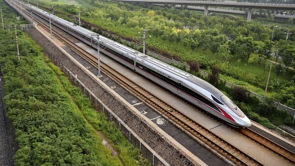 In this Aug. 21, 2017 photo released by China's Xinhua News Agency, a Fuxing bullet train, China's latest high-speed train, arrives at a train station in northern China's Tianjin Municipality - Sputnik International