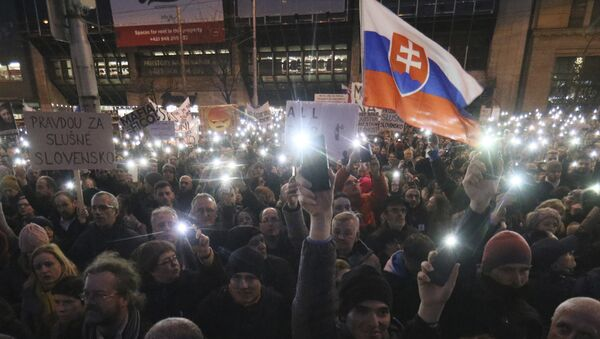 Demonstrators light with the torches of their smartphones during an anti-government rally in Bratislava, Slovakia, Friday, March 9, 2018. The country-wide protests demand a thorough investigation into the shooting deaths of Jan Kuciak and Martina Kusnirova, whose bodies were found in their home on Feb. 25, and also demand changes in the government. - Sputnik International