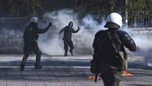 A masked protester throws a molotov cocktail at riot policemen during clashes outside the University of Thessaloniki campus, in Thessaloniki, Greece Saturday March 10, 2018 - Sputnik International
