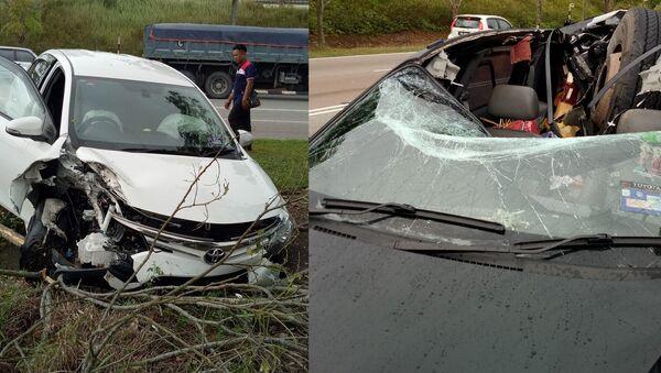 Lorry's Runaway Tire Causes Near-Fatal Damage on Malaysian Highway - Sputnik International