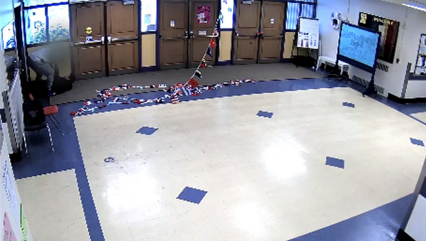 Security guard stationed at Washington Middle School in Washington State gets caught slamming student to the ground on surveillance camera. - Sputnik International