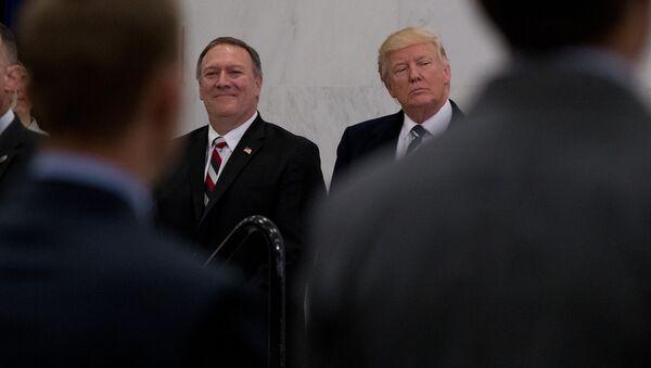 President Donald Trump, accompanied by CIA Director-designate Rep. Michael Pompeo, left, waits to speak at the Central Intelligence Agency in Langley, Va., Saturday, Jan. 21, 2017 - Sputnik International